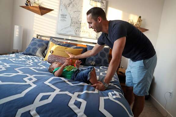 Nick Williams and his son, Rio, 15 months, at their new residence in Station House development in West Oakland neighborhood of Oakland, Calif., on Wednesday, September 6, 2017.