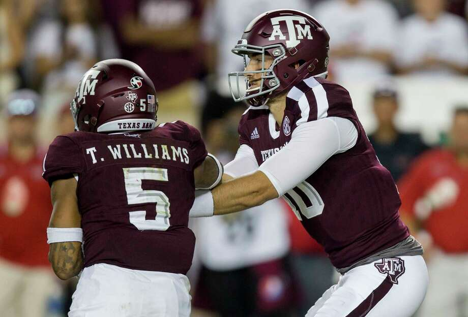 Texas A&M quarterback Jake Hubenak (10) hands the ball off to running back Trayveon Williams (5) during the third quarter of an NCAA college football game against Nicholls State Saturday, Sept. 9, 2017, in College Station, Texas. Texas A&M won 24-14. (AP Photo/Sam Craft) Photo: Sam Craft, FRE / Internal