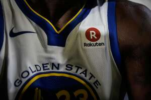 The Rakuten sponsorship badge is seen on player Draymond Green's jersey following a press conference that announces a jersey sponsorship deal between Rakuten and the Golden State Warriors in Oakland, Calif., on Tuesday, Sept. 12, 2017.
