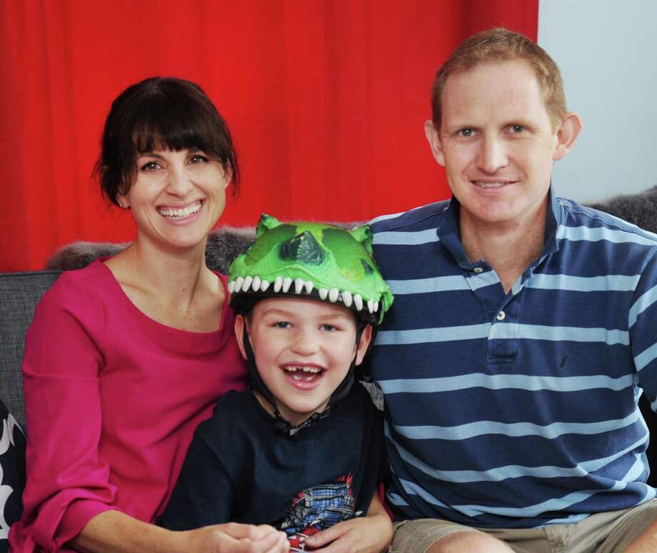 Husband and wife Nicholas and Allyson Buck with their son, Sam, 7, at their home in Greenwich, Conn., Friday, Sept. 8, 2017. Sam has vanishing white matter disease, an inherited condition caused by a defective protein that prevents the body from making enough myelin. Myelin is the white fatty substance that insulates nerve fibers and protects them from damage. Photo: Bob Luckey Jr. / Hearst Connecticut Media / Greenwich Time
