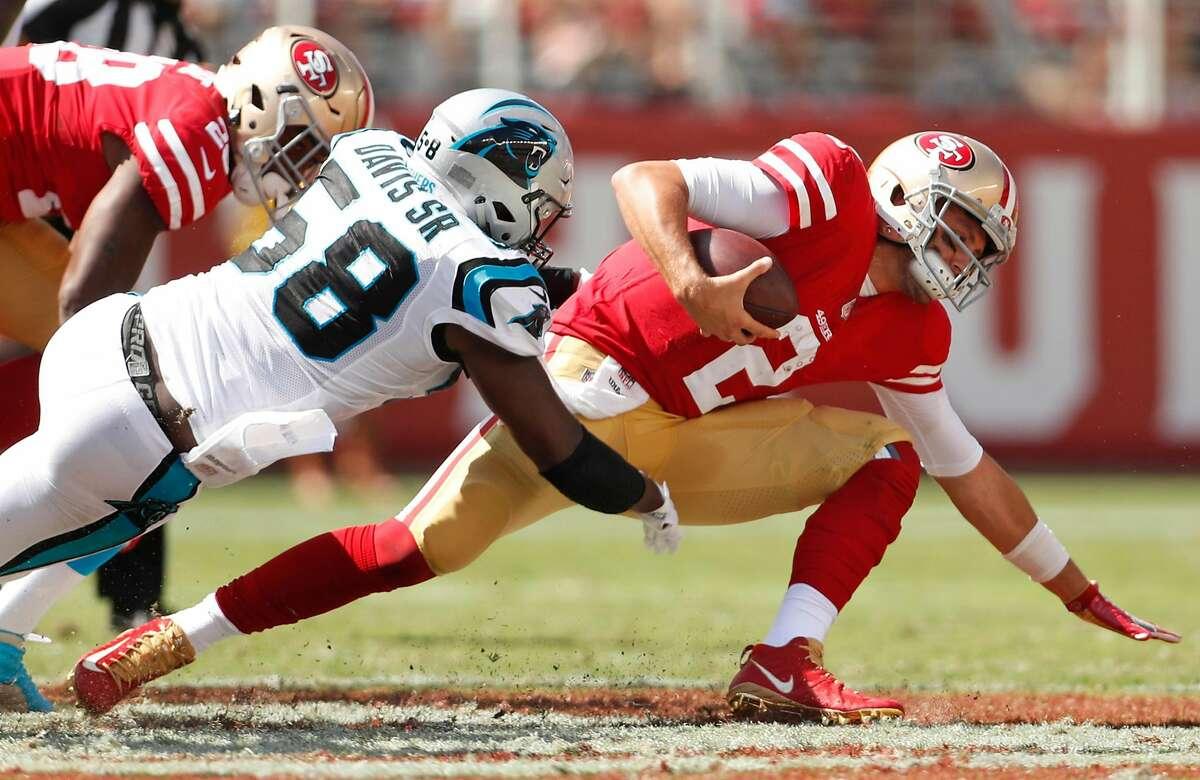 San Francisco 49ers' Brian Hoyer is sacked by Carolina Panthers' Thomas Davis, Sr. during 3rd quarter of Panthers' 23-3 win during NFL game at Levi's Stadium in Santa Clara, Calif., on Sunday, September 10, 2017.