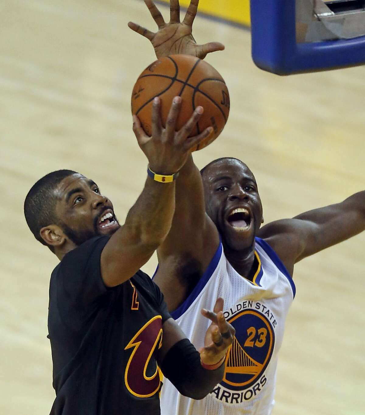 Golden State Warriors' Draymond Green can't stop Cleveland Cavaliers' Kyrie Irving in 3rd quarter of Game 7 of the NBA Finals at Oracle Arena in Oakland, Calif., on Sunday, June 19, 2016.