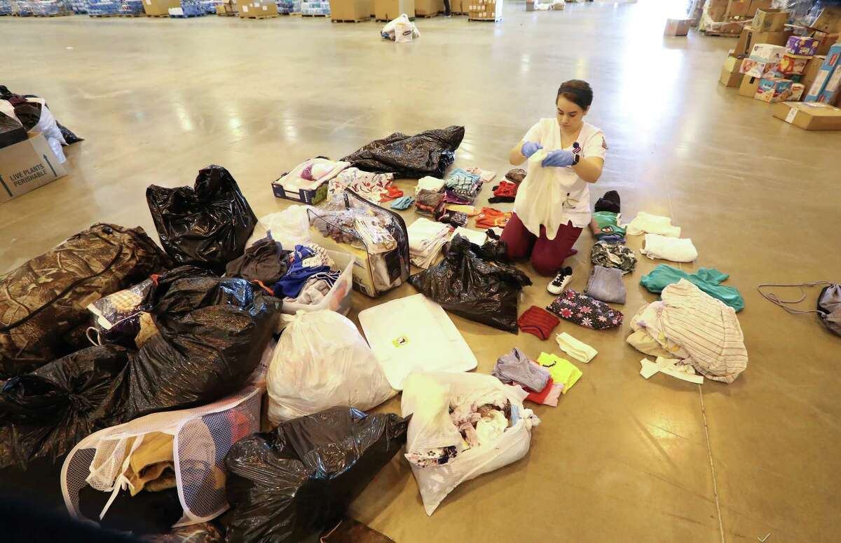 Lillian Sharp, Texas Women's University, sorts clothes in the NRG Center shelter Tuesday, Sept. 12, 2017, in Houston.