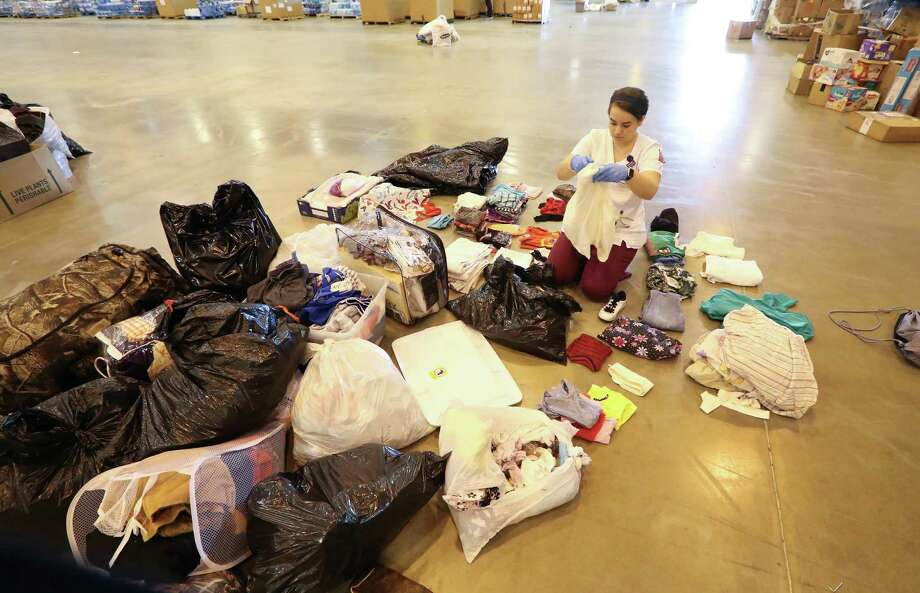 Lillian Sharp, Texas Women's University, sorts clothes in the NRG Center shelter Tuesday, Sept. 12, 2017, in Houston. Photo: Steve Gonzales, Houston Chronicle / © 2017 Houston Chronicle