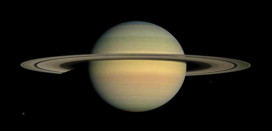 This July 23, 2008 image made available by NASA shows the planet Saturn, as seen from the Cassini spacecraft. After a 20-year voyage, Cassini is poised to dive into Saturn on Friday, Sept. 15, 2016.  (NASA/JPL/Space Science Institute via AP) Photo: HOGP / NASA