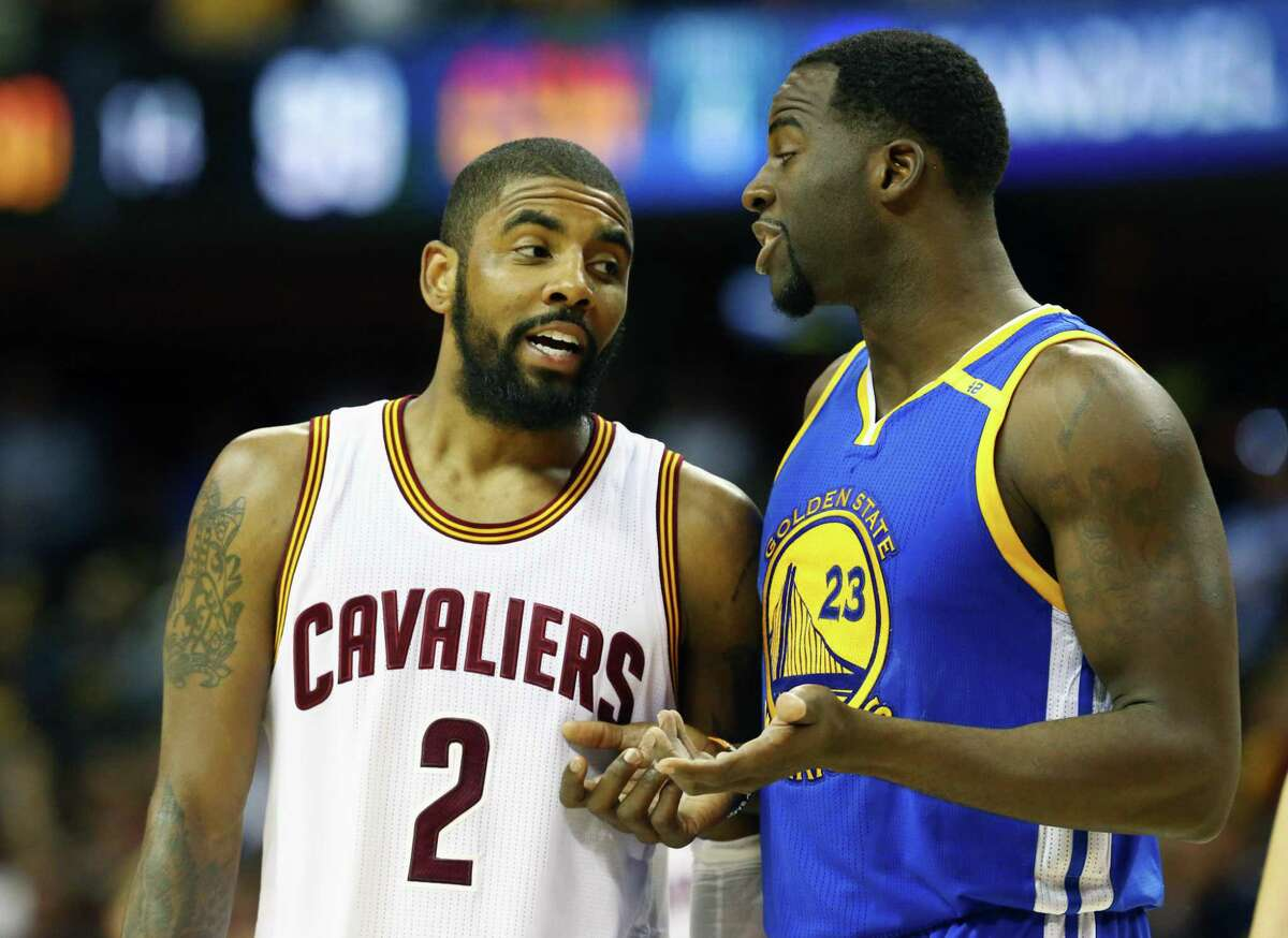 CLEVELAND, OH - JUNE 07: Kyrie Irving #2 of the Cleveland Cavaliers and Draymond Green #23 of the Golden State Warriors exchange words during the second half in Game 3 of the 2017 NBA Finals at Quicken Loans Arena on June 7, 2017 in Cleveland, Ohio. NOTE TO USER: User expressly acknowledges and agrees that, by downloading and or using this photograph, User is consenting to the terms and conditions of the Getty Images License Agreement. (Photo by Ronald Martinez/Getty Images)