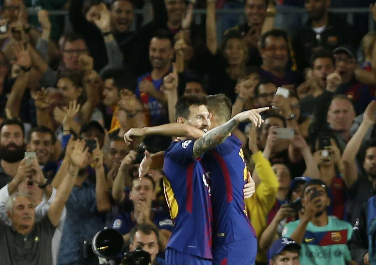 Barcelona's Lionel Messi celebrates scoring his side's third goal during a Champions League group D soccer match between FC Barcelona and Juventus at the Camp Nou stadium in Barcelona, Spain, Tuesday, Sept. 12, 2017. (AP Photo/Francisco Seco)