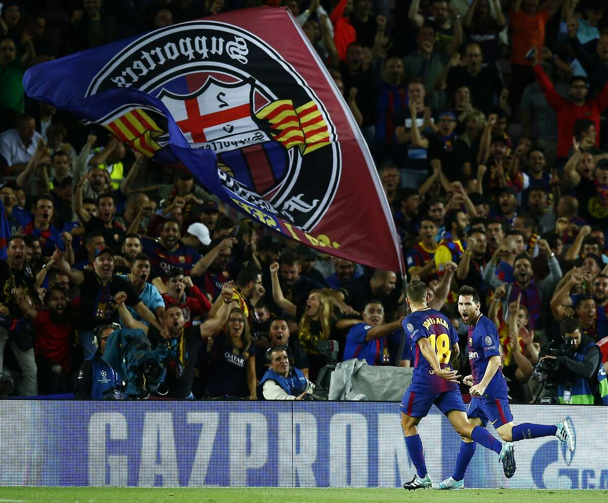 Barcelona's Lionel Messi celebrates scoring his side's first goal during a group D Champions League soccer match between FC Barcelona and Juventus at the Camp Nou stadium in Barcelona, Spain, Tuesday, Sept. 12, 2017. (AP Photo/Manu Fernandez)
