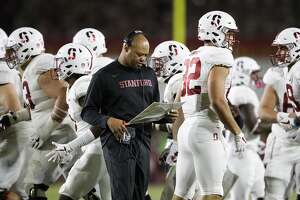 Stanford head coach David Shaw looks t his play chart during the second half of an NCAA college football game against Southern California, Saturday, Sept. 9, 2017, in Los Angeles. (AP Photo/Jae C. Hong)