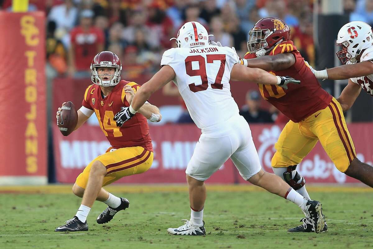 LOS ANGELES, CA - SEPTEMBER 09: Sam Darnold #14 of the USC Trojans avoids pressure from Dylan Jackson #97 of the Stanford Cardinal during the second quarter at Los Angeles Memorial Coliseum on September 9, 2017 in Los Angeles, California. (Photo by Sean M. Haffey/Getty Images)