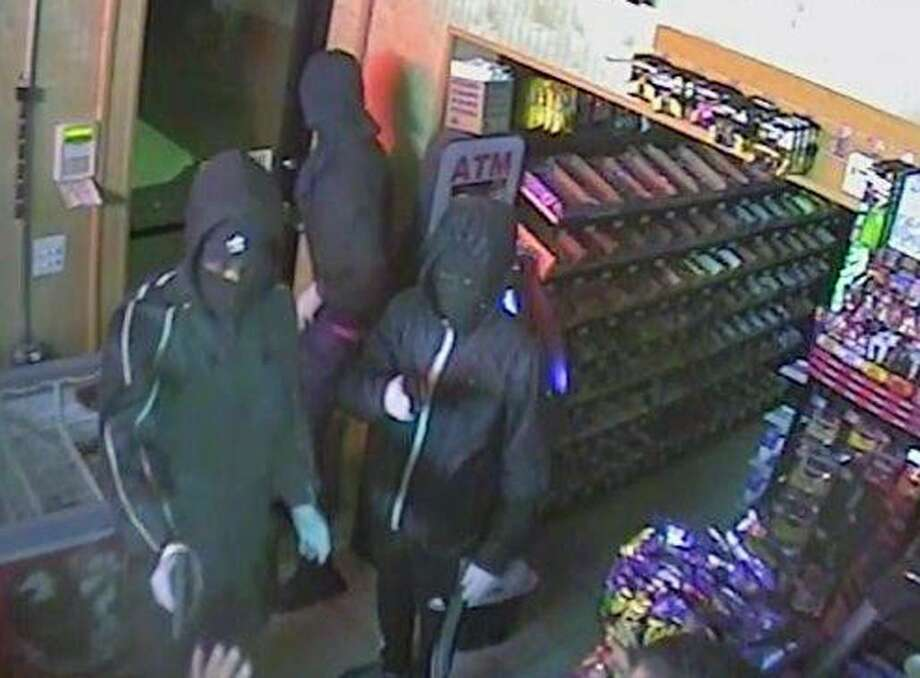Police responded to the BP gas station at 3725 Madison Avenue in Bridgeport, Conn., around 11:36 p.m. Monday, Sept. 11, 2017, for a report that three armed males robbed the gas station and pistol-whipped the clerk in the head before they fled behind Goodfellas Pizza, located at 3741 Madison Avenue. Photo: Contributed Photo / Bridgeport Police Department / Contributed Photo / Connecticut Post Contributed