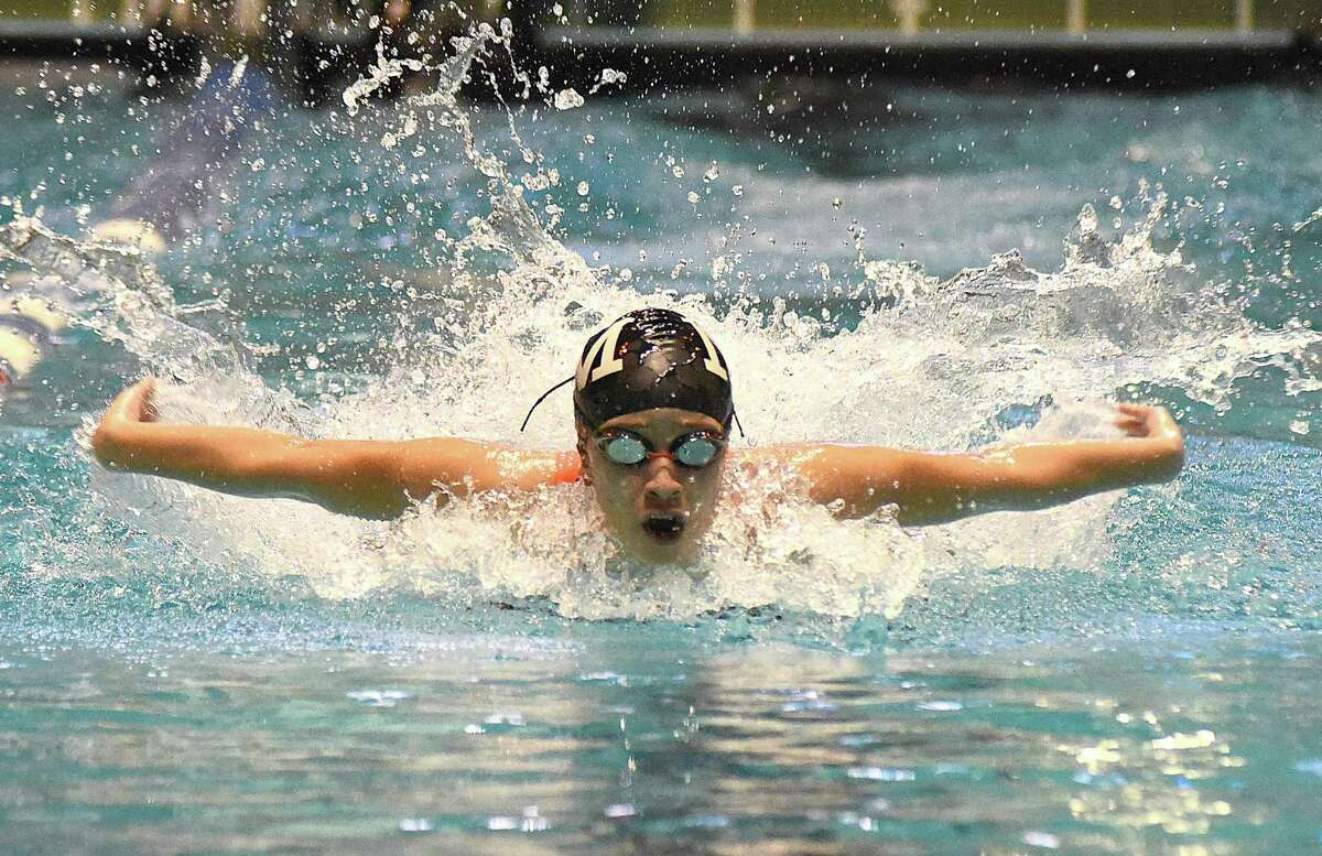 Norwalk-McMahon's Ashley Calderon competes in the butterfly leg of the 200 medley relay during Saturday's State Open girls swimming championship meet at Yale University. Greenwich won the state open title for the second straight season.
