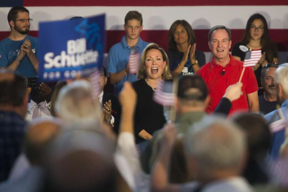 Michigan Attorney General Bill Schuette of Midland and his wife, Cynthia Grebe, greet a crowd before Schuette announces his gubernatorial campaign during a barbecue fundraiser Tuesday at the Midland County Fairgrounds. (Katy Kildee/kkildee@mdn.net) Photo: (Katy Kildee/kkildee@mdn.net)