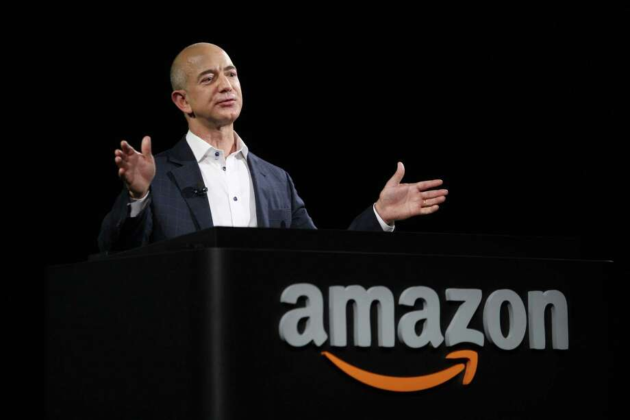 At the close of the U.S. stock market Friday, Amazon's  Jeff Bezos had a net worth of $93.8 billion.  Photo: David McNew, Stringer / 2012 Getty Images
