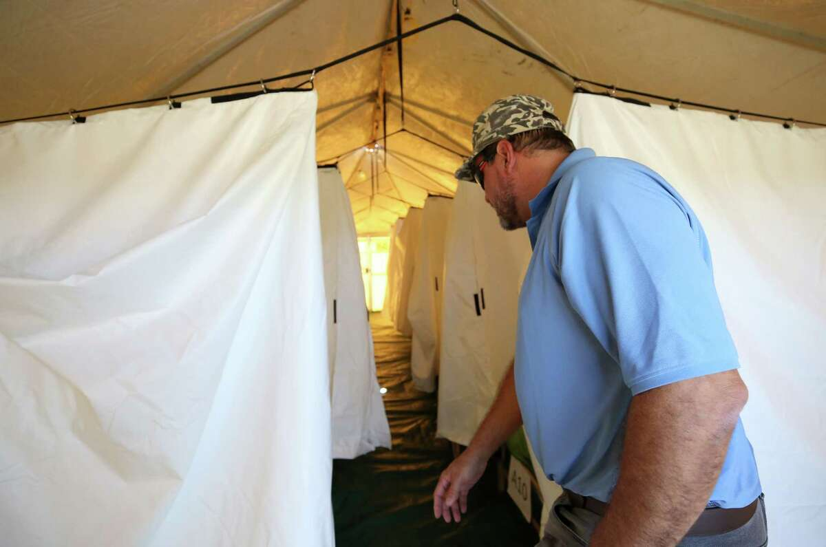 Farmers Village at Wake Nation Houston co-mayor Jeff Losey walks through one of the sleeping spaces at the village Tuesday, Sept. 12, 2017, in Rosharon, Texas. Renting the private space meant the company would not be using as many hotel rooms within the Houston area. ( Godofredo A. Vasquez / Houston Chronicle )