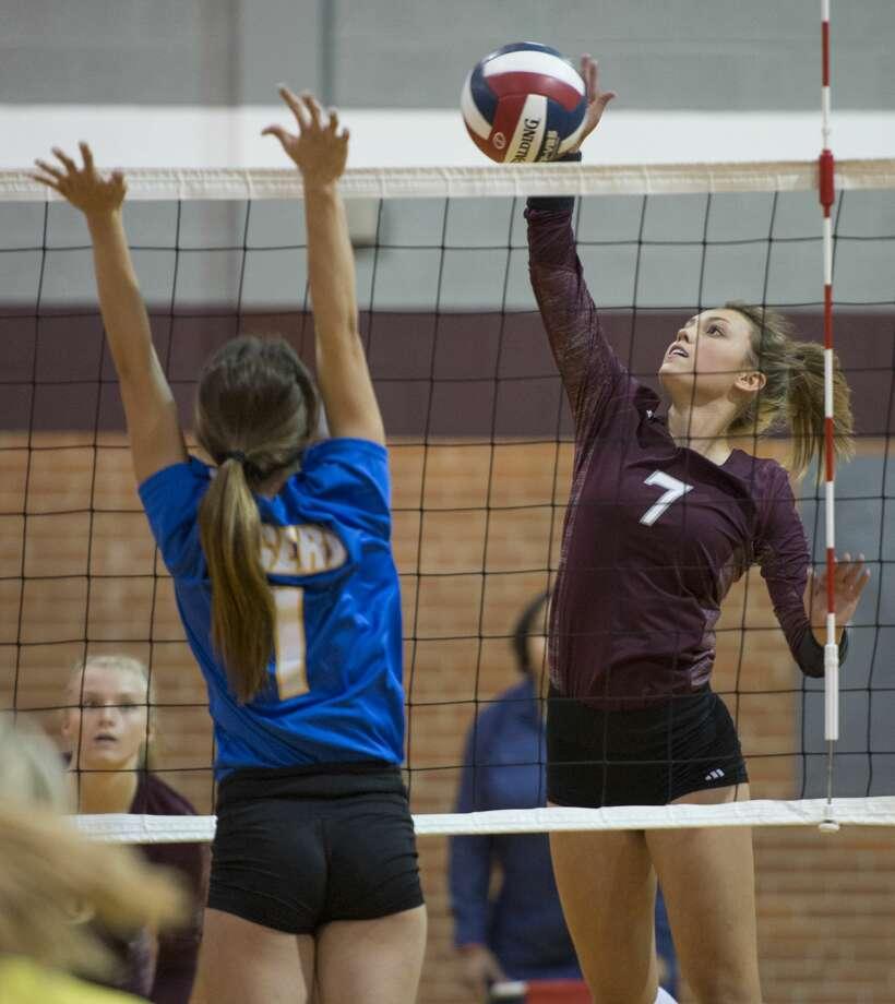 Lee High's Elizabeth Kuhn looks to get the ball past Frenship's Reagan Snuggs 9/12/17 at LHS gym. Tim Fischer/Reporter-Telegram Photo: Tim Fischer/Midland Reporter-Telegram