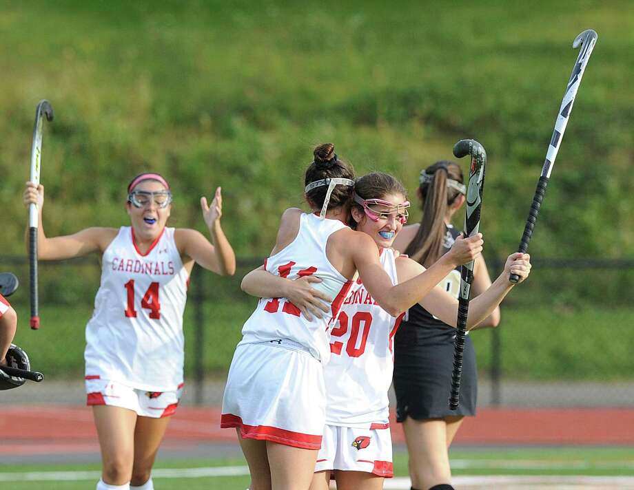 Jennie Piotrzkowski (20) of Greenwich, right, is congratulated by teammate Paige Finneran (11), center, after Piotrzkowski scored a second-half goal on a deflection in field hockey against Trumbull High Tuesday. In the background at left is Courtney Swift of Greenwich. Photo: Bob Luckey Jr. / Hearst Connecticut Media / Greenwich Time