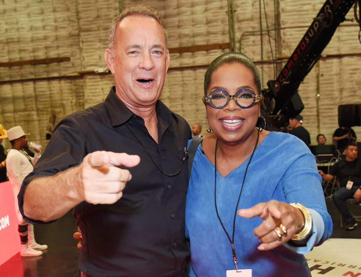 UNIVERSAL CITY, CA - SEPTEMBER 12: In this handout photo provided by Hand in Hand, Tom Hanks and Oprah Winfrey attend Hand in Hand: A Benefit for Hurricane Relief at Universal Studios AMC on September 12, 2017 in Universal City, California. (Photo by Kevin Mazur/Hand in Hand/Getty Images)