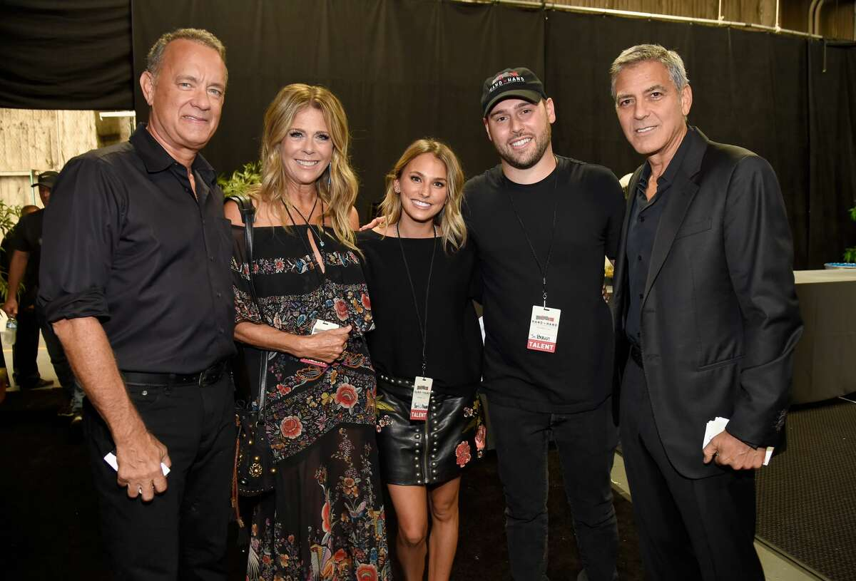 UNIVERSAL CITY, CA - SEPTEMBER 12: In this handout photo provided by Hand in Hand, Tom Hanks, Rita Wilson, Yael Cohen Braun, Scooter Braun and George Clooney attend Hand in Hand: A Benefit for Hurricane Relief at Universal Studios AMC on September 12, 2017 in Universal City, California. (Photo by Kevin Mazur/Hand in Hand/Getty Images)