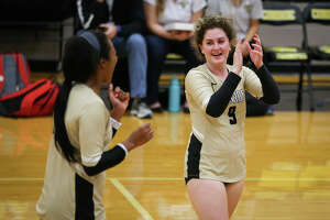 Conroe's Sophie Harrison (9) celebrates with teammates during the varsity volleyball game against Huffman Hargrave on Tuesday, Sept. 12, 2017, at Conroe High School. (Michael Minasi/ Chronicle)