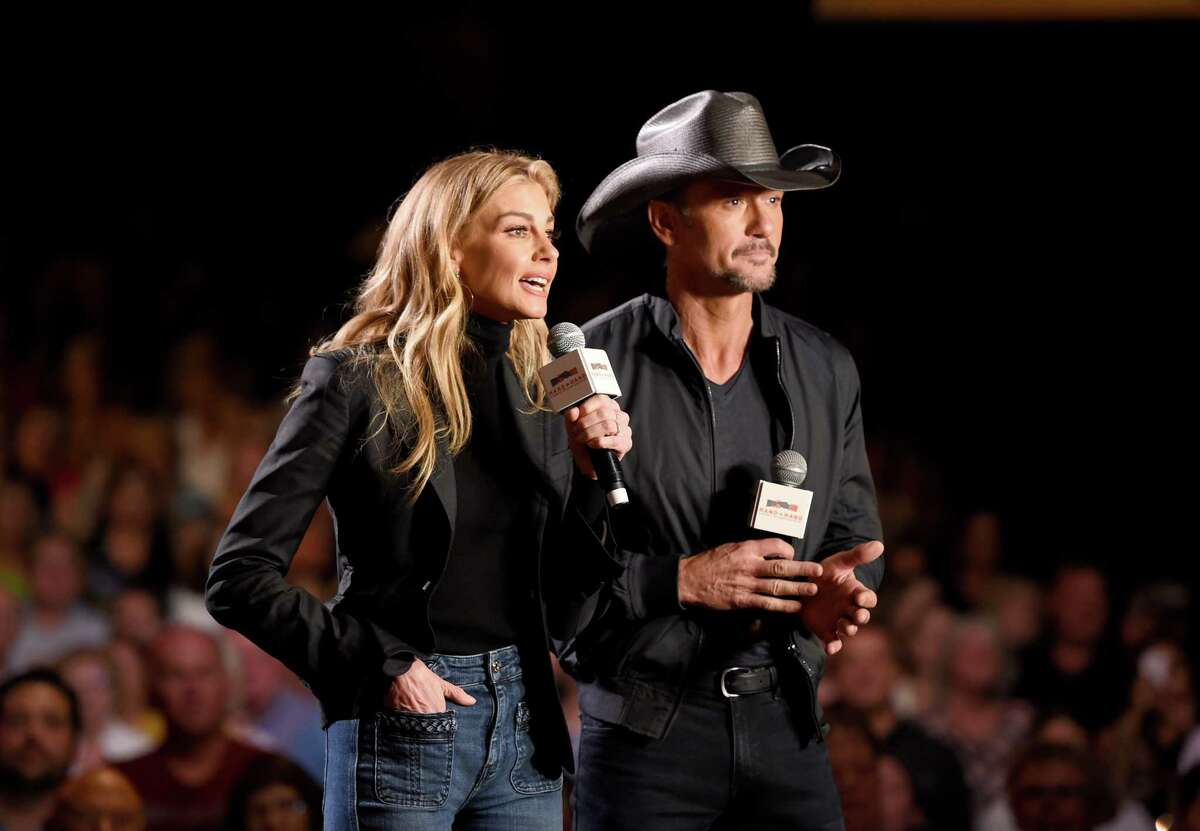 NASHVILLE, TN - SEPTEMBER 12: In this handout photo provided by Hand in Hand, Faith Hill and Tim McGraw speak onstage during Hand in Hand: A Benefit for Hurricane Relief at the Grand Ole Opry House on September 12, 2017 in Nashville, Tennessee.