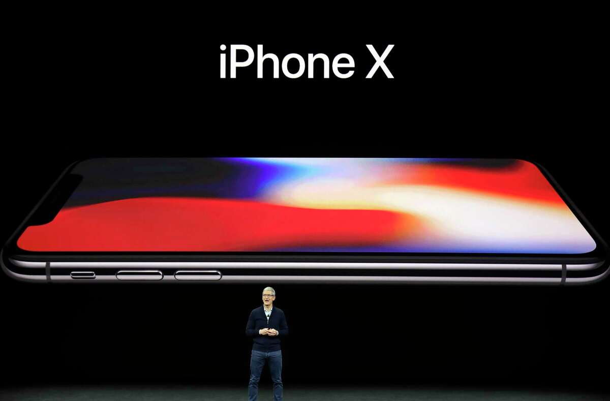 Apple CEO Tim Cook announces the new iPhone X at the Steve Jobs Theater on the new Apple campus, Tuesday, Sept. 12, 2017, in Cupertino, Calif. (AP Photo/Marcio Jose Sanchez) ORG XMIT: FX160
