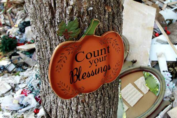 """A sign reading """"Count your Blessings"""" is seen outside Peggy Cardwell's home after Hurricane Harvey caused more than four feet of water to flood her home on South Woodloch Street, Tuesday, Sept. 12, 2017, in Woodloch. """"I have to be reminded of how bless I really am,"""" Cardwell said. """"There are plenty of other people who lost everything."""""""