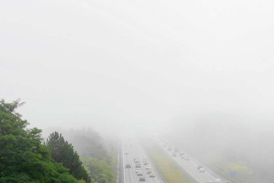 Drivers head into and out of the fog on Route 7 on Tuesday morning, Sept. 12, 2017, in Latham, N.Y.     (Paul Buckowski / Times Union)