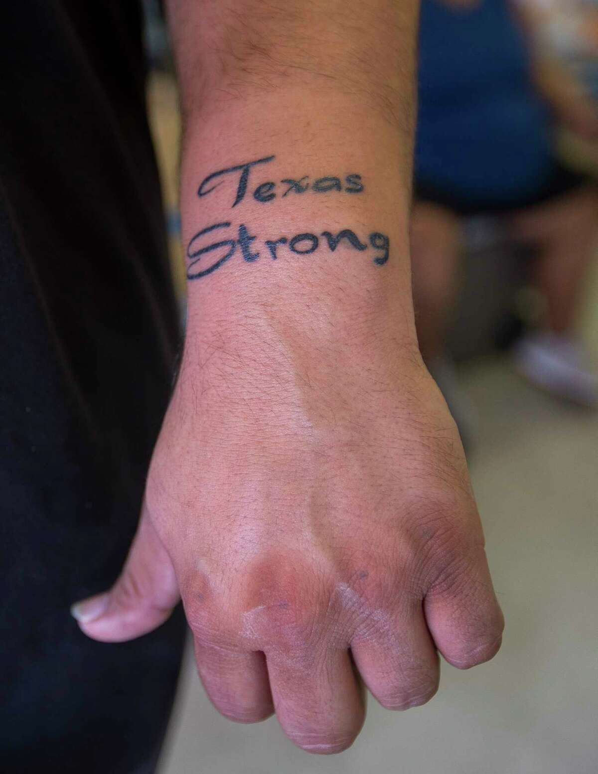 """""""Surviving"""" is how Brian Torres, of Tivoli, TX, describes the reason for his new 'Texas Strong' tattoo, Tuesday, Sept. 12, 2017. Torres rode the storm out in a trailer in Tivoli, an unincorporated town located between Port Lavaca and Rockport, a harrowing experience he likens to that feeling when a plane is just about to touch down on the runway and bounces continuously."""