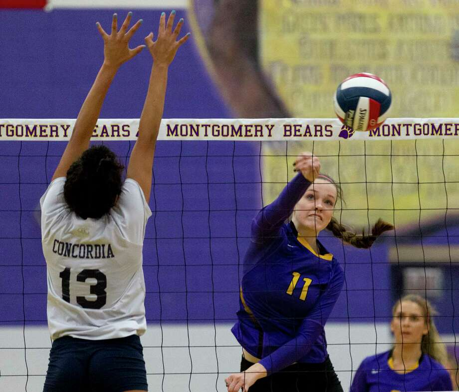Montgomery middle blocker Mallory Talbert (11) scores a point during the second set of a non-district high school volleyball match at Montgomery High School, Tuesday, Sept. 12, 2017. Photo: Jason Fochtman, Staff Photographer / © 2017 Houston Chronicle