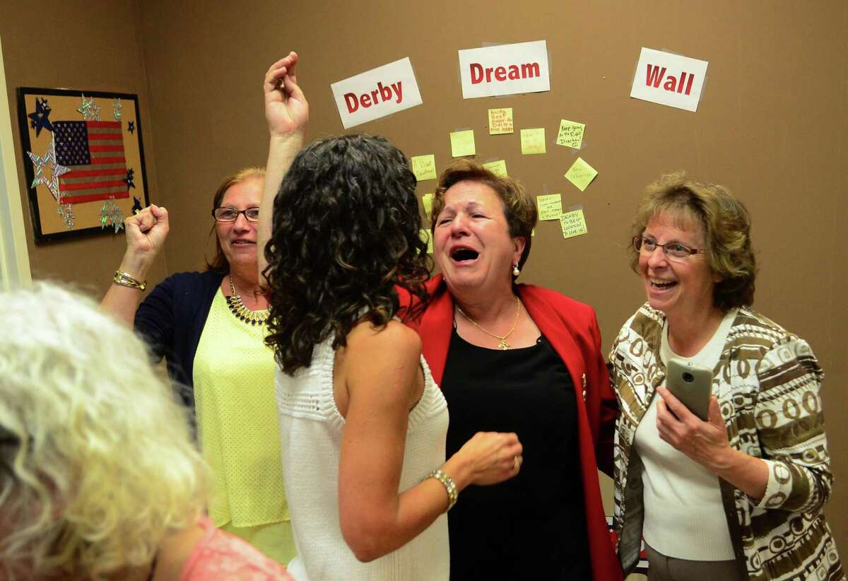 Mayor Anita Dugatto, center, celebrates with volunteers and supporters in her primary election win over opponent Carmen DiCenso at Dugatto's campaign headquarters in Derby, Conn., on Tuesday Sept. 12, 2017.