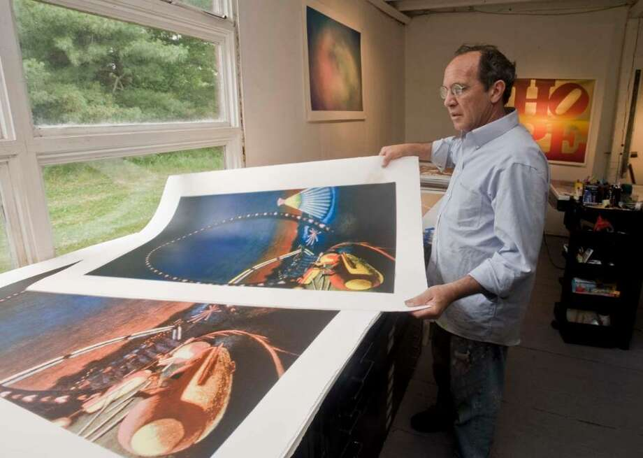 Artist and printer Gary Lichtenstein pages through his silk screens of Jane Dickson's art at his studio in Ridgefield. Tuesday, June 22, 2010 Photo: Scott Mullin / The News-Times Freelance