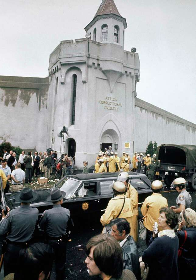 FILE - In this Sept. 13, 1971 file photo, prison guards and New York State troopers gather outside Attica State Prison as they prepare to enter the prison and retake it after inmates rioted and held the prison for five days, in Attica, N.Y. More than 40 years after the nation's bloodiest prison rebellion, newly released documents contain accounts, some never before seen publicly, from National Guardsmen and a doctor who said they saw injured inmates beaten with clubs and others with wounds indicating they were tortured as state police and guards retook control. (AP Photo, File) ORG XMIT: NYR202 Photo: Uncredited / AP