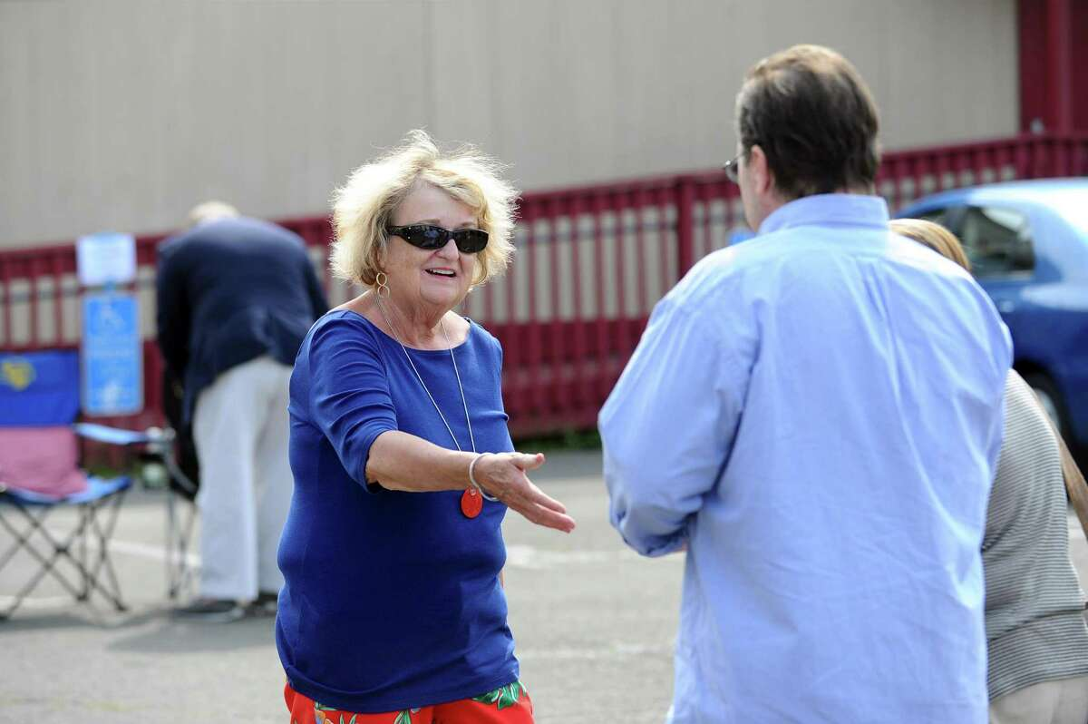 District 8 candidate Eileen Heaphy, a Democrat, goes to shake the hand of a voter during the primary election in Stamford on Tuesday.