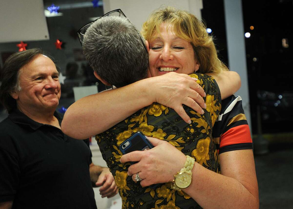 State Rep. Laura Hoydick, right, is hugged by supporter Margo Paquette as she arrives at Republican Headquarters following her victory in the GOP mayoral primary in Stratford on Tuesday.