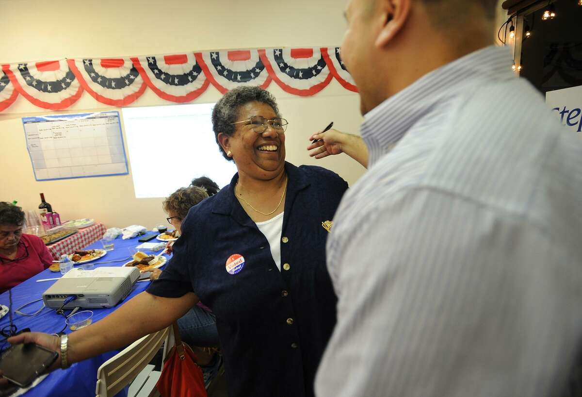 Stephanie Philips, left, hugs campaign strategist Jalmar DeDios following her victory in the Democratic mayoral primary in Stratford on Tuesday.