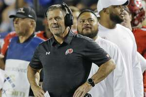 Utah coach Kyle Whittingham watches from the sideline during the first half of an NCAA college football game against BYU on Saturday, Sept. 9, 2017, in Provo, Utah. (AP Photo/Rick Bowmer)