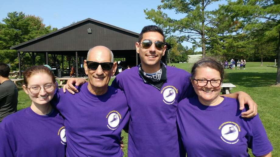 The backbone of Team DeBerry on Sunday, Sept. 10, 2017, for the Lustgarten Foundation's Albany Pancreatic Cancer Research Walk at Elm Avenue Town Park in Delmar (from left): Lindsey DeBerry, Tom DeBerry, Michael DeBerry and Heidi DeBerry. (Photo courtesy Heidi DeBerry)   ORG XMIT: L-mTfVpb9k6jUxnOpjuv