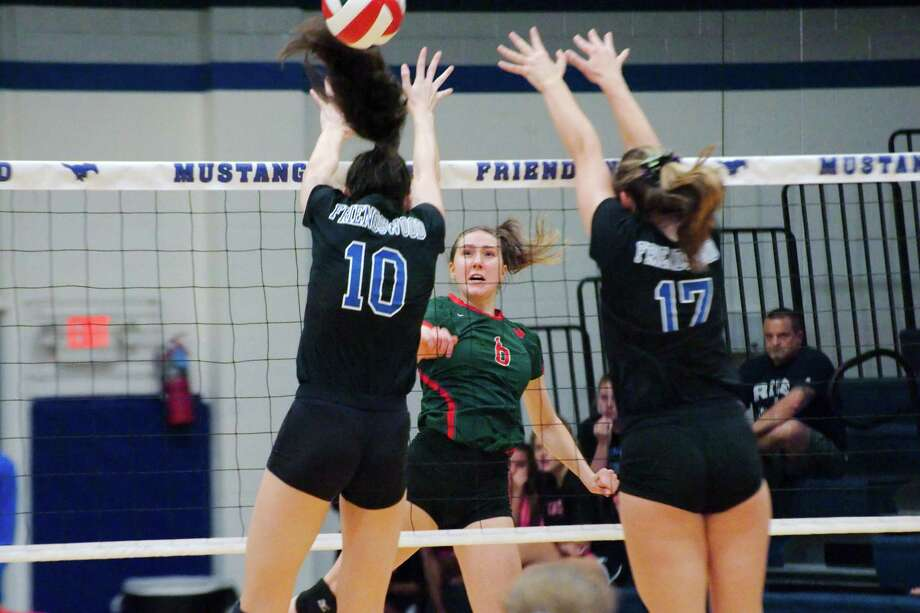 Friendswood's McKenna Fridye (10) and Madison Weisinger (17)  try to block a shot by The Woodlands' Courtney Heiser (6) Tuesday, Sep. 12. Photo: Kirk Sides / © 2017 Kirk Sides / Houston Chronicle