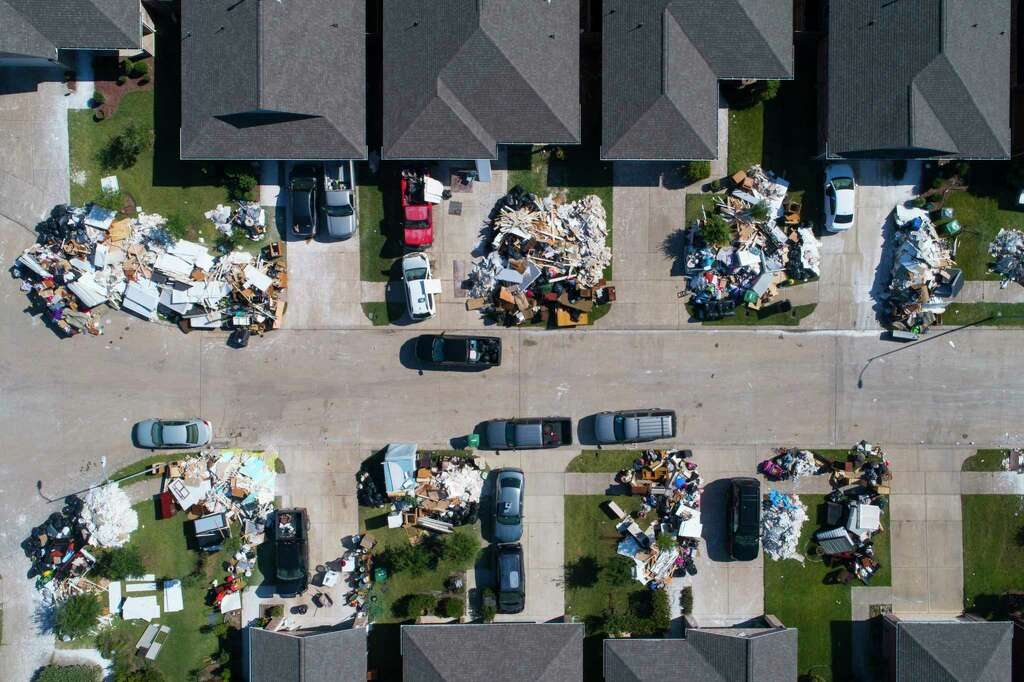 Houston Christmas Tree Pickup Part - 46: Debris Sits Outside Homes In Harrel Park, Houston Habitat For Humanityu0027s  Newest Subdivision In Houston