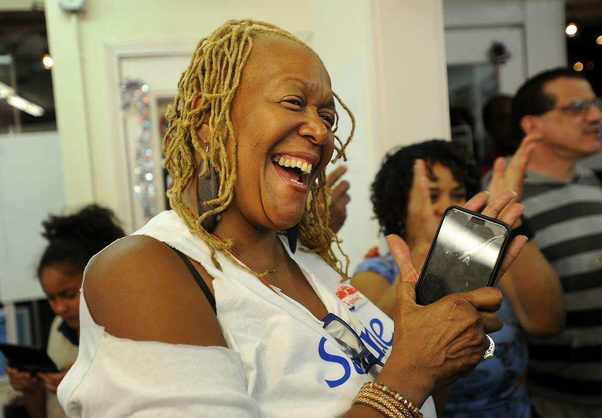 Sylvia Woolfolk-Martin, long time friend of Stephanie Philips, applauds Philips' victory speech in the Democratic mayoral primary in Stratford, Conn. on Tuesday, September 12, 2017.