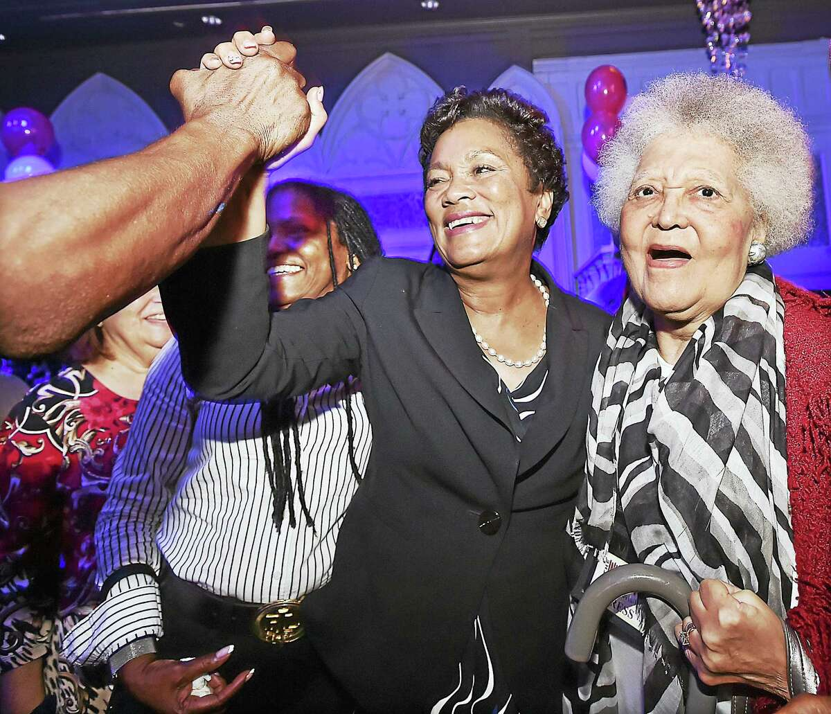 Mayor Toni Harp, center, celebrates her primary win while posing for a picture with Arlene Davis-Rudd of the Inner City News Tuesday at Vanity, 144 Temple St.