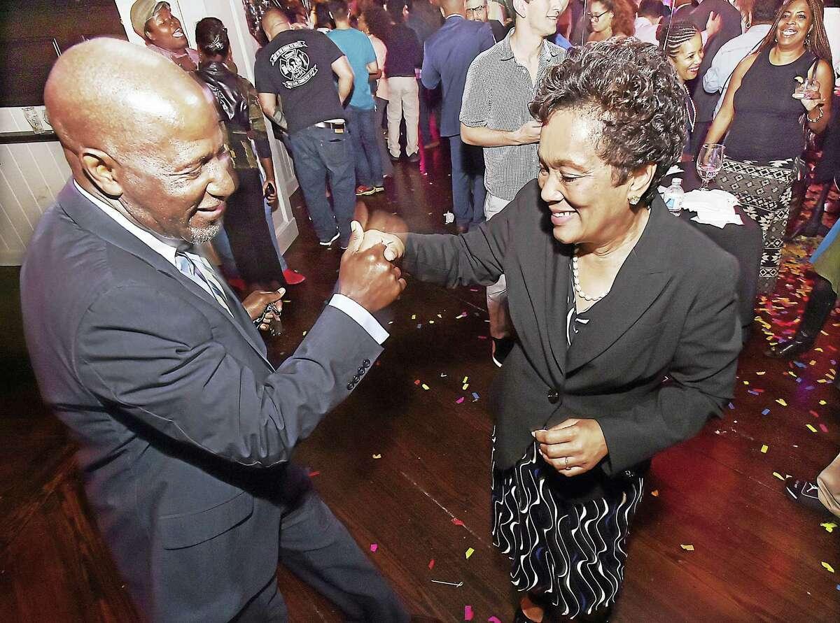 Leonard Webb of Hamden dances with Mayor Toni Harp at Vanity Tuesday following her win in the Demnocratic primary.