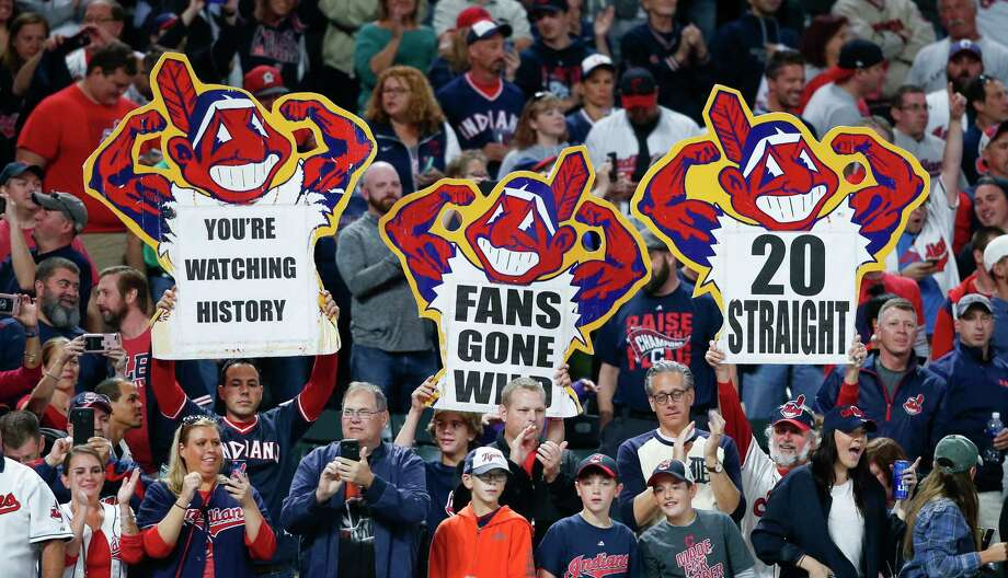 Cleveland Indians fans celebrate a 2-0 victory over the Detroit Tigers in a baseball game, Tuesday, Sept. 12, 2017, in Cleveland. The Indians won their 20th game in a row, tying the American League record. (AP Photo/Ron Schwane) Photo: Ron Schwane, Associated Press / AP 2017