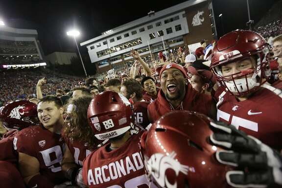Washington State players celebrate after their team won an NCAA college football game 47-44 in triple overtime against Boise State in Pullman, Wash., Saturday, Sept. 9, 2017. (AP Photo/Young Kwak)