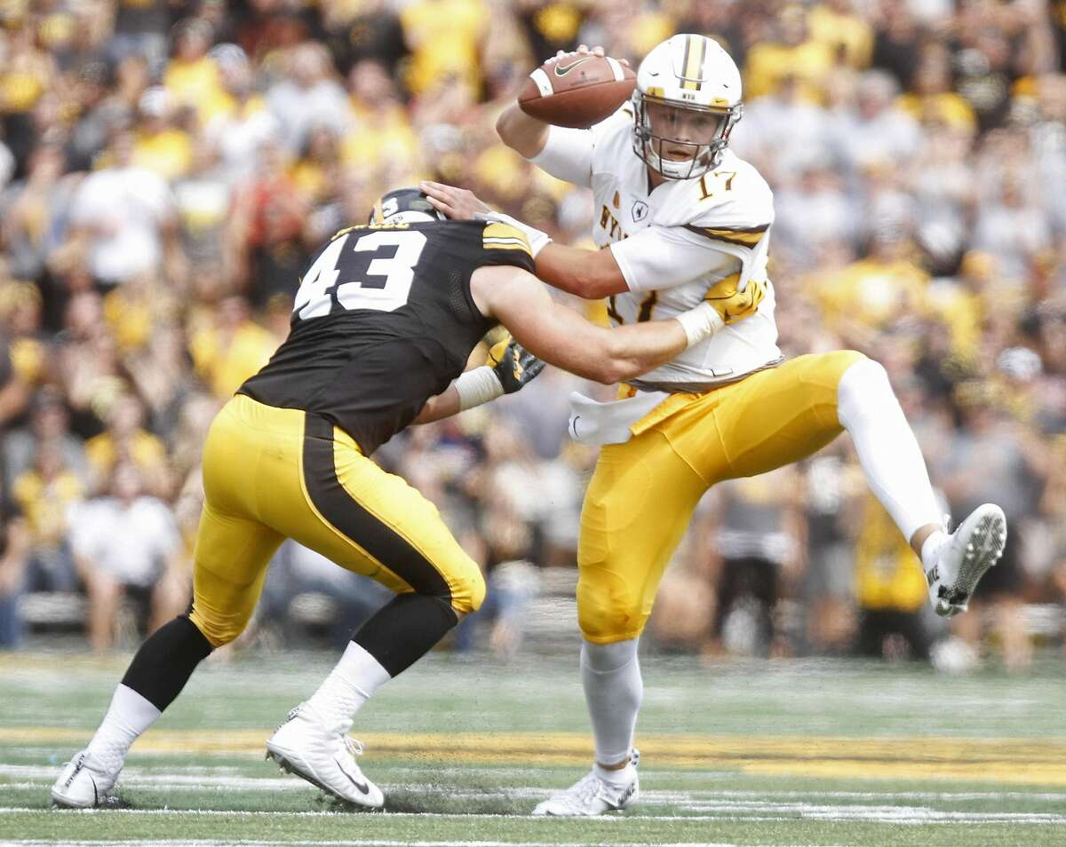 IOWA CITY, IOWA- SEPTEMBER 2: Quarterback Josh Allen #17 of the Wyoming Cowboys escapes a tackle from linebacker Jose Jewell #43 of the Iowa Hawkeyes during the second quarter, on September 2, 2017 at Kinnick Stadium in Iowa City, Iowa. (Photo by Matthew Holst/Getty Images)