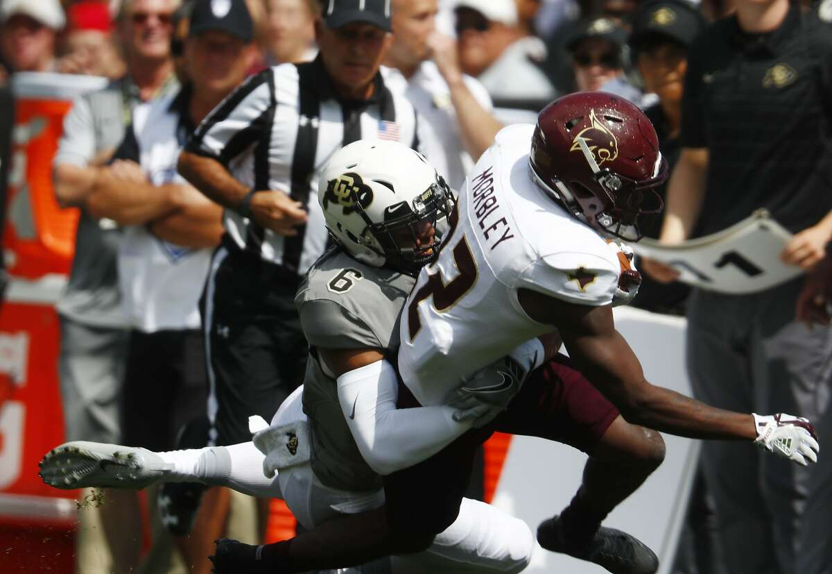Colorado Buffaloes defensive back Evan Worthington pulls down Texas State Bobcats wide receiver Thurman Morbley (22) in the first half of an NCAA college football game Saturday, Sept. 9, 2017, in Boulder, Colo. (AP Photo/David Zalubowski)