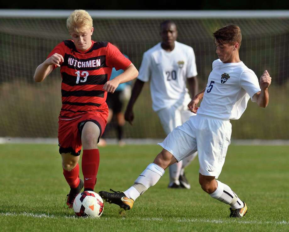 Guilderland's Daniel Tietjen (13) and Christian Brothers Academy's Dylan Bogden (5) chase a loose ball during a Suburban Council boys' high school soccer game in Colonie, N.Y., Tuesday, Oct. 12, 2017. (Hans Pennink / Special to the Times Union) ORG XMIT: HP107 Photo: Hans Pennink / Hans Pennink