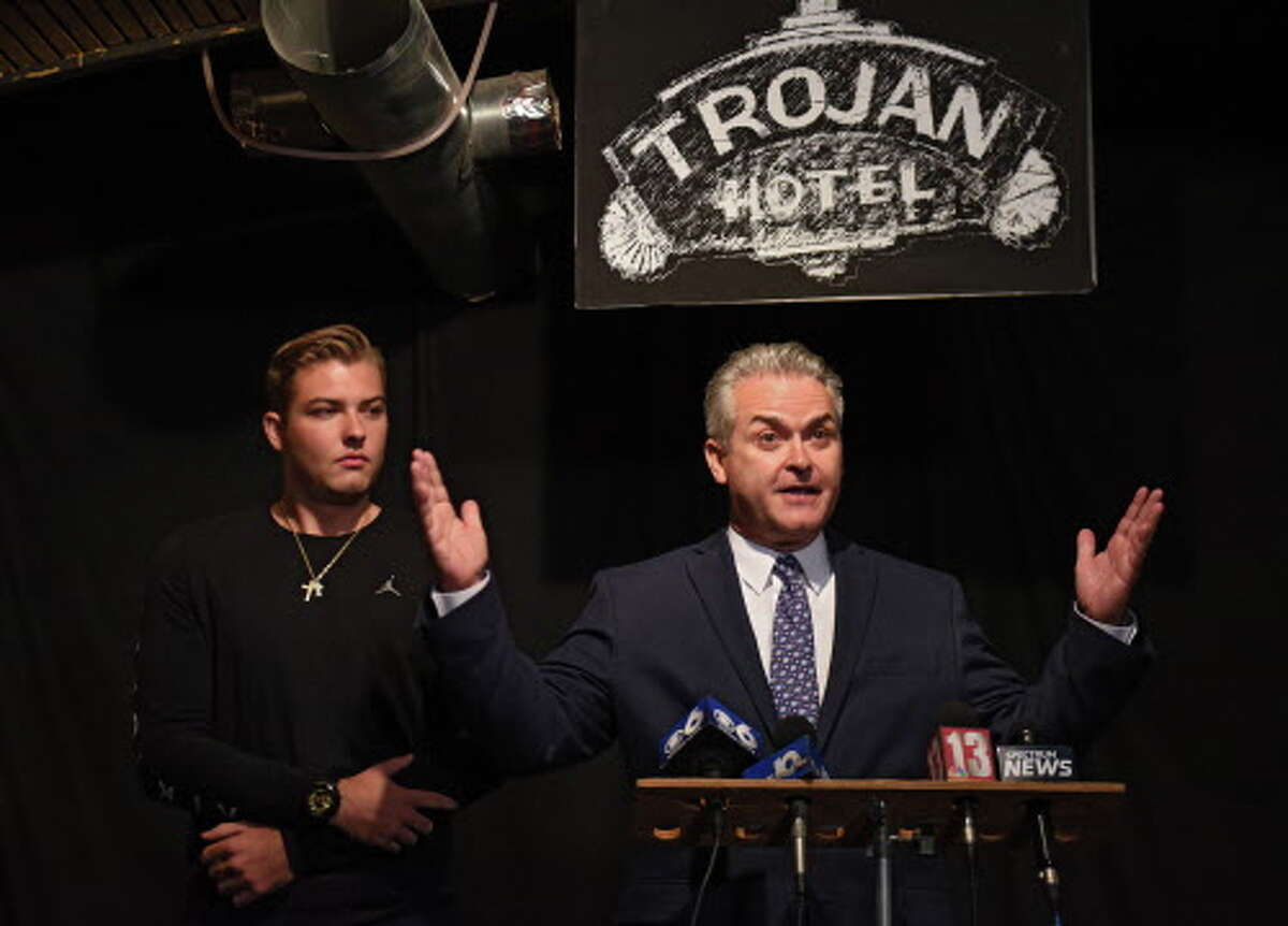 Assemblyman Steven McLaughlin declares victory in the Rensselaer County executive primary race at O'Brien's Public House on Tuesday Sept. 12, 2017 in Troy, N.Y. His son Danny stands next to him at left. (Lori Van Buren / Times Union)