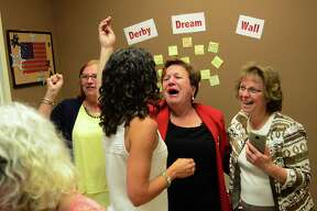 Mayor Anita Dugatto, center, celebrates with volunteers and supporters in her primary election win over opponent Carmen DiCenso at Dugatto's campaign headquarters in Derby on Tuesday.